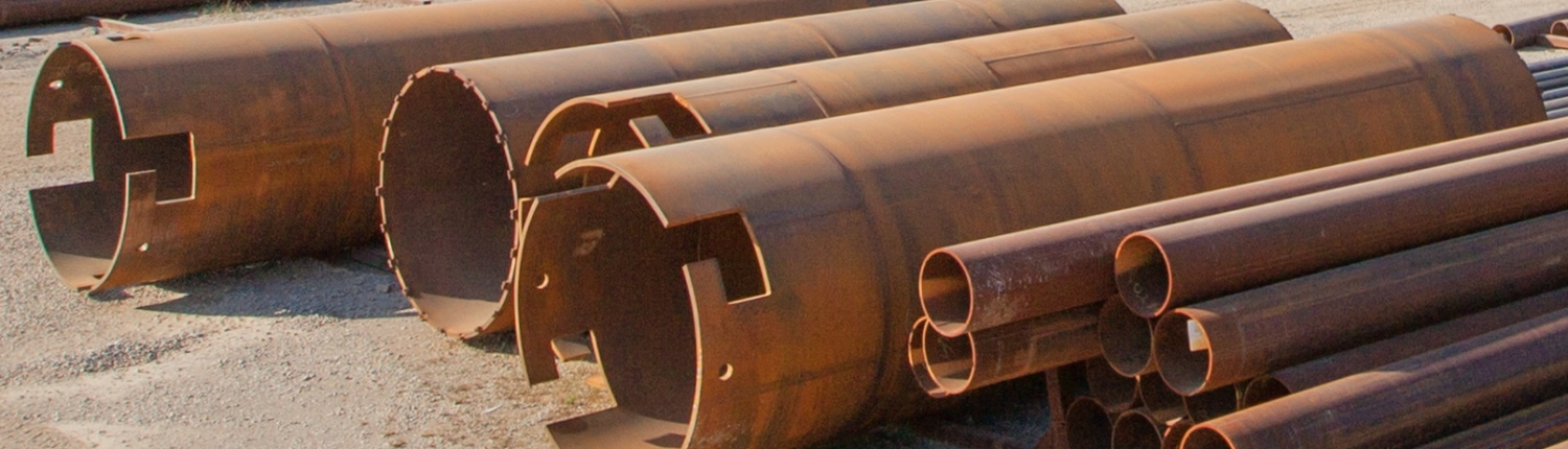 view of various sized pipes in yard