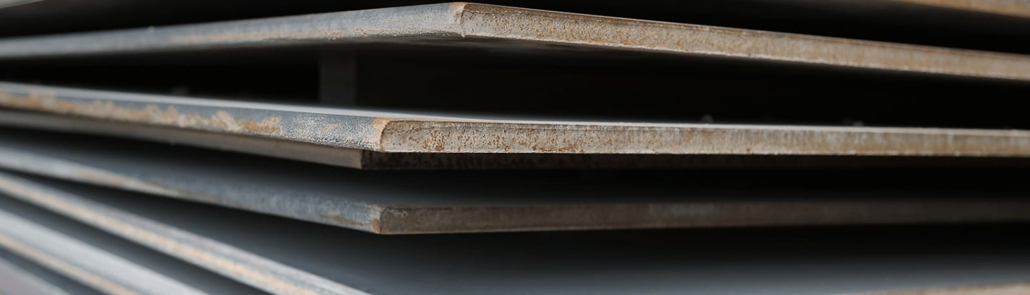 Close up stack of steel road plates