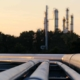 Close up view of refinery pipe at dusk